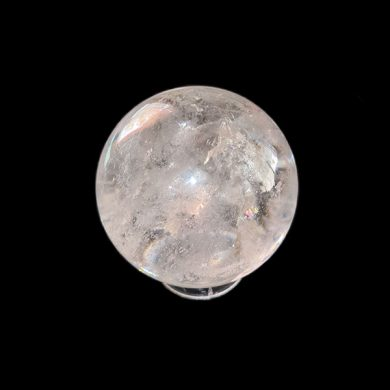 Clear quartz sphere on stand